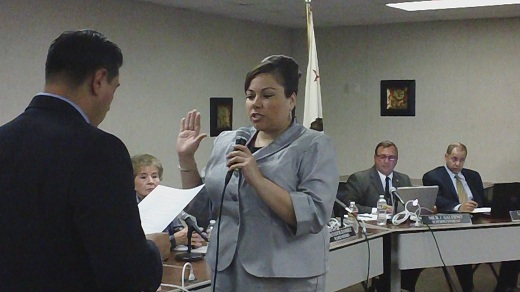 Maria Elena taking the oath Maria Elena Talamantes Assumes Office on the El Monte Union High School Board of Trustees